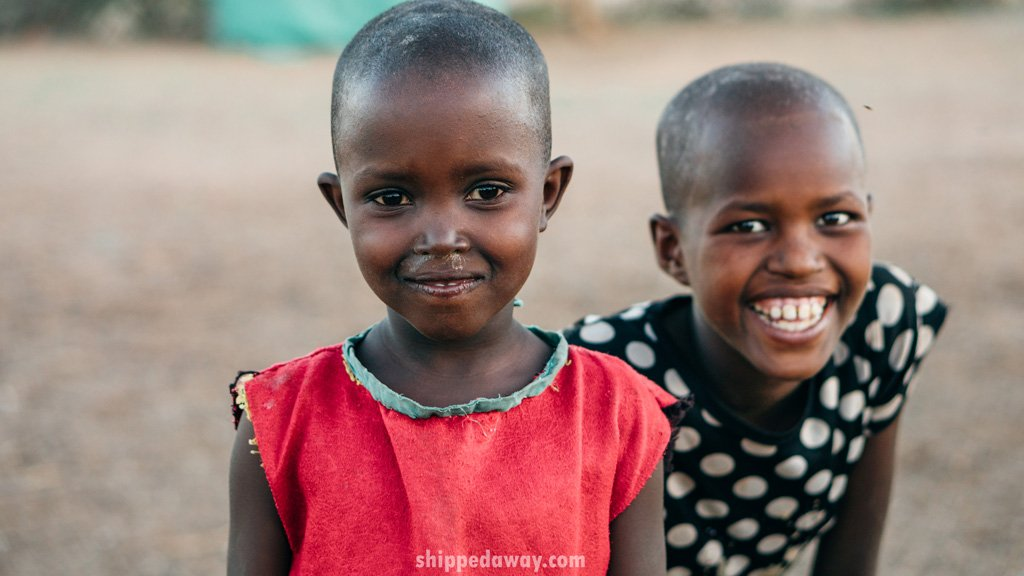 Kids from the Maasai Samburu tribe in Kenya smiling at the camera