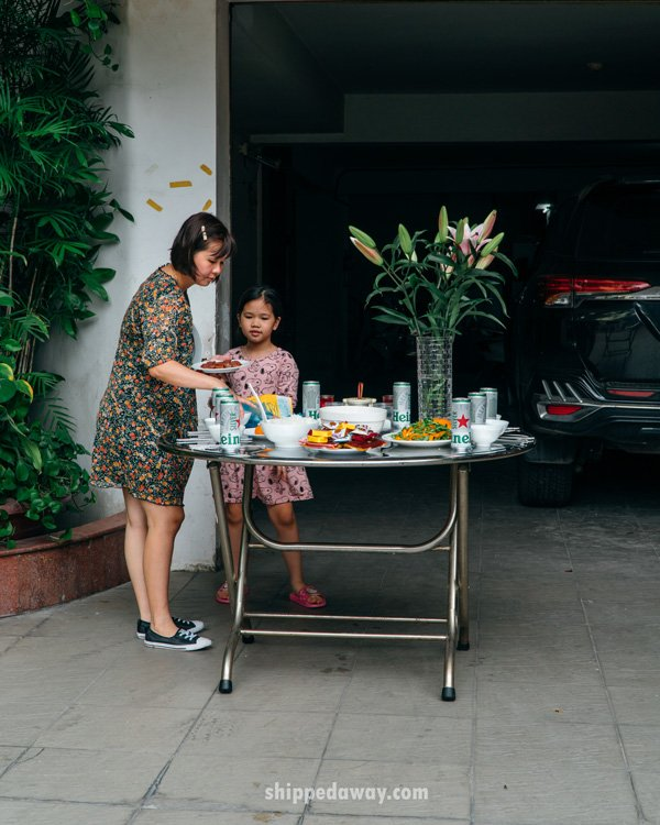 Mother and child preparing offerings during Tet, Vietnamese New Year