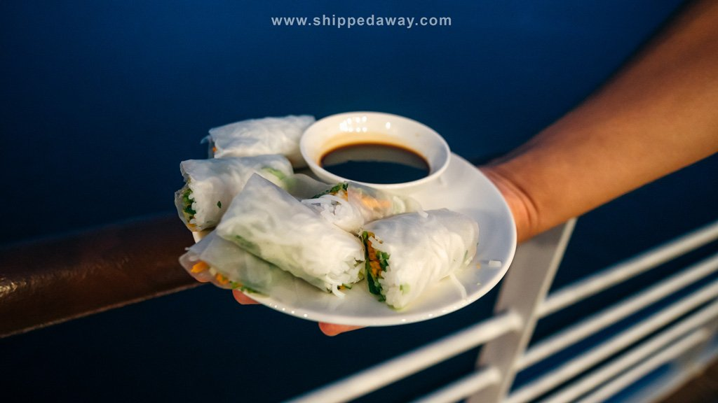 Cooking spring rolls at Capella cruise Ha Long