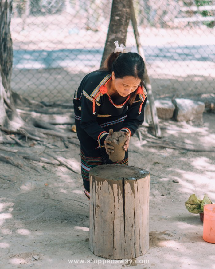 Hmong woman making pottery without pottery wheel