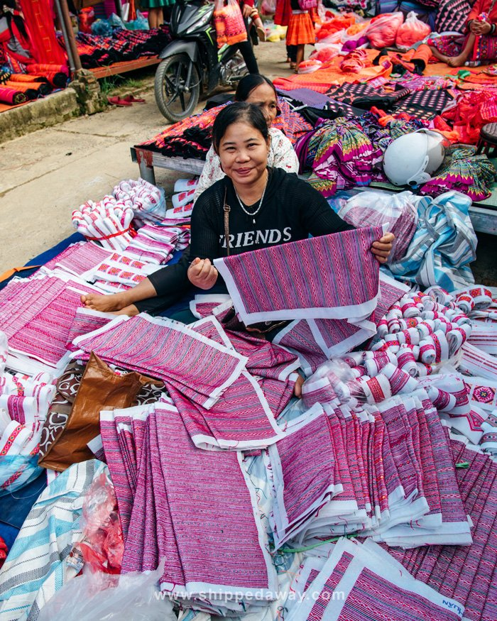 Local woman selling fabric at Pa Co Market, Vietnam