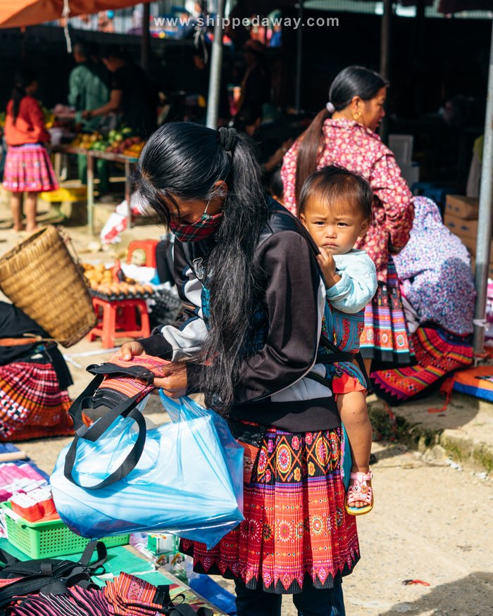 Young Hmong buying goods at Pa Co Market in Vietnam