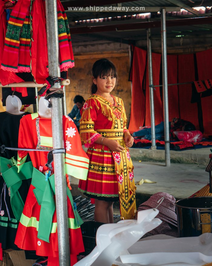 Young lady trying on new clothes at Pa Co Market, Vietnam