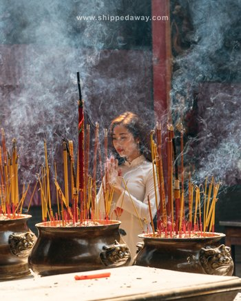 Praying in Chinese temple, Ho Chi Minh City