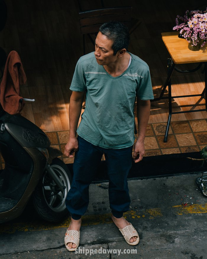 Man keeping others safe at Hanoi's Train Street